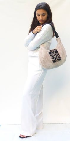 Italian ladies handmade one-of-a-kind handbags. This slouchy vegan fur  handbag 5e50f5813e01a