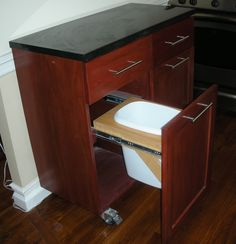 mobile kitchen island...ok now just have 2 full-size garbage cans in that drawer and we are set :)