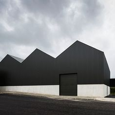 Portuguese architect Joao Mendes Ribeiro designed this corrugated steel and concrete warehouse for a components manufacturer but prior to moving in its art collector-owner filled the space with work by Andy Warhol John Baldessari and Antony Gormley. Read the full story on dezeen.com #architecture by dezeen