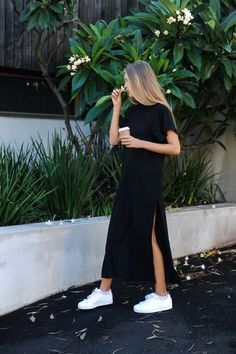 black casual maxi slit dress and white sneakers - Lupsona