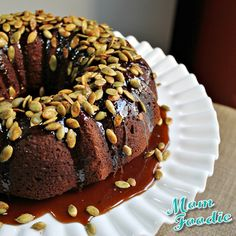 oatmeal molasses pumpkin cake with caramel glaze and candied pumpkin seed topping from blommi.com