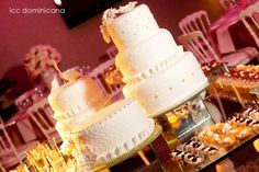 mini beige wedding cakes with gold details