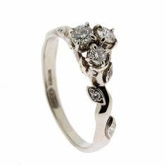 Rose and thorn engagement ring - white gold