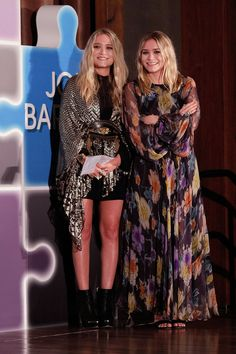 Mary-Kate belted a metallic chevron-print wrap over her black staples, then slipped on a pair of leather ankle boots. Ashley was all smiles in a sheer floral gown and dual-strap sandals. Elizabeth Olsen, Ashley Mary Kate Olsen, Ashley Olsen Style, Olsen Twins Style, Nicole Richie, Ann Taylor, Blazers, Floral Gown, Celebrity Style