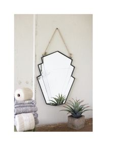"This mirror may be little, but it's got lots of character. From it's art deco design to it's rope hanger, it brings vintage appeal to your home. Just the facts ma'am: W = 15"" H = 20"""