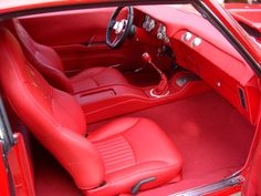 1969 Chevy Camaro Custom Interiors Restoration | 1969 Camaro Seats and Upholstery Interiors red interior console 69