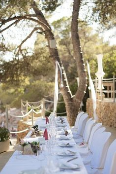 Simplicity at the bride and groom's table with chairs that complement the wedding table decor to perfection.