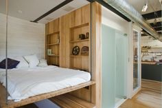 """a bed that can be raised into the ceiling; from """"Silo House"""", Cornell University's entry for Solar Decathlon 2009"""