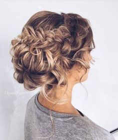 This classy updo is perfect for spring brides!! Tie your hair back into a gorgeous low bun with a thick braid on the side to add extra accents and dimension