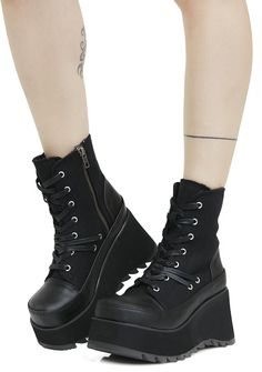 Demonia Scene Lace-Up Platform Boots cuz you slay the scene, bb...These sikk af boots feature chunky lightweight platforms, contrasting faux leather and canvas construction, lace-ups with additional lace and grommet detail and inner ankle zipper closures.