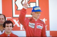 1984: Marlboro McLaren drivers Alain Prost of France and Niki Lauda of Austria stand on the winners'' podium after the Portuguese Grand Prix at the Estoril circuit in Portugal. Prost finished in first place and Lauda in second. Mandatory Credit: Mike Powell/Allsport