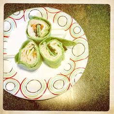 Roasted chicken pinwheels: garden vegetable cream cheese, deli sliced roasted chicken, provolone cheese, shredded carrot and field greens rolled inside a spinach wrap. Divide will tooth picks, slice and enjoy.
