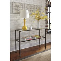 Shop Joss & Main for your Estee Console Table. A glamorous mix of clear tempered glass and brushed gold and silver finished metal, the look of this console table is both airy and luxe.