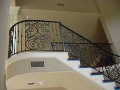 Amazing Black Wrought Iron Stair Railing with Solid Brown Wood . Wrought Iron Staircase, Wrought Iron Stair Railing, Stair Railing Design, Iron Balusters, Stair Handrail, Railing Ideas, Cheap Stair Parts, Stair Paneling, Tuscany