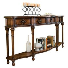 Brimming with classic style and timeless charm, this refined design brings lasting appeal to your home.    Product: Console table...