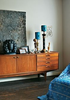 Mid-century modern. Teak with denim blue. Light wood cabinet dark wood floor