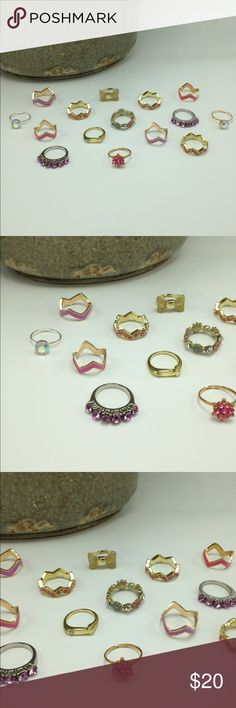 NWT Bundle lot 15 rings Purple pink flower gold New with Tags! Bundle lot of 15 Dainty Stacked rings. Mixed Metals. Lead & Nickel free. Rings are one size. You will receive all of the rings shown. Not sold individually. No trades. R#1017 EVN Accessories Jewelry Rings