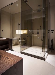 Love the shower drainage tracks. And the tinted shower screens. And the timber bench.