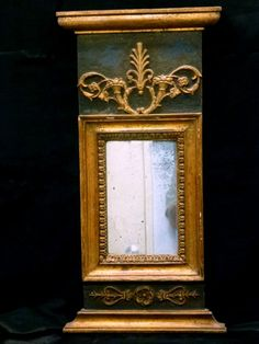 Swedish empire mirror ca.1810.Has original paint, mirror and wood backing.Very light weight.22 3/4in by 11 1/2in(57cm by 29cm)