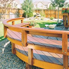 Curved Bench A curved rail and cantilevered bench wrap around this deck, creating a pleasing addition to the rectangular backyard.