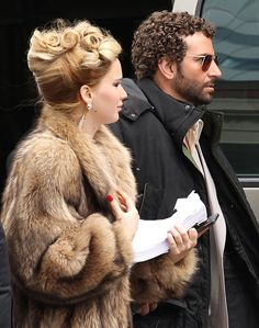 "Jennifer Lawrence & Bradley Cooper on the set of ""American Hustle"""
