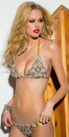 LABYRINTH Gold Stud - Crystal Bikini by Sauvage Swimwear  In perfect harmony with the pattern choice and color, gold bands circle around the neck and waist to further create a warm and comforting atmosphere, as well as give it a unique look, like all Sauvage swimwear suits do. #sauvageswimwear