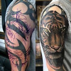 Tiger cover up tattoo by Seb! Limited av… Tiger cover up tattoo by Seb! Limited availability at Revival Tattoo Studio. Tribal Tattoo Cover Up, Best Cover Up Tattoos, Black Tattoo Cover Up, Tribal Sleeve Tattoos, Cover Tattoo, Tattoo Ink, Chest Tattoo, Skull Tattoo Design, Dragon Tattoo Designs