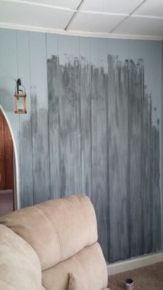 Faux barnwood. .painting paneling Base/light blue and gray streaking with cheesecloth