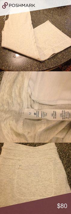 NWOT Lululemon sweatpants sz12 gray Drawstring and 1 back zipper pocket. Never worn. I believe they are called the voyage pant or something like that:) lululemon athletica Pants Straight Leg