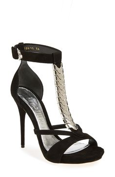 Ooh la la! The mix of black suede and silver hardware make this Alexander McQueen sandal a show stopping winner.