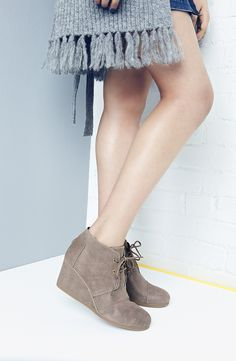 A just-right tonal wedge gives a lift in a modern suede desert TOMS bootie that's totally suited for fall.