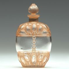 """R. LALIQUE Perfume bottle for Jay Thorpe, """"Jaytho,"""" clear and frosted with sepia patina, c. 1928."""