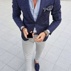 Consider pairing a deep blue wool suit jacket with grey slim jeans for drinks after work. Feeling inventive? Complement your outfit with dark blue suede tassel loafers. Shop this look on Lookastic: https://lookastic.com/men/looks/blazer-dress-shirt-skinny-jeans/24000 — Light Blue Gingham Dress Shirt — Navy Gingham Pocket Square — Navy Wool Blazer — Black Bracelet — Silver Watch — Black Woven Leather Belt — Grey Skinny Jeans — Navy Suede Tassel Loafers