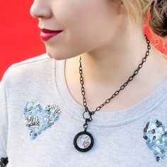 Really like the black chain and locket with the hearts.