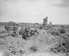 Battle of the Scarpe. Capture of Greenland Hill by 51st division. Daylight patrol of 6th Battalion Seaforth Highlanders working forward towards Hausa and Delbar Woods. North-East of Roeux. Crossing an old trench in No Man's Land.