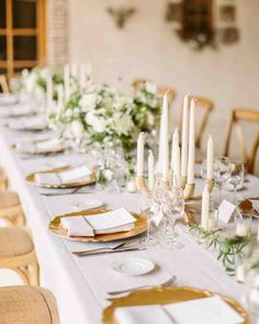 An Elegant, Intimate Wedding in the French Countryside | Martha Stewart Weddings - White floral arrangements and a mix of candles lined the table.