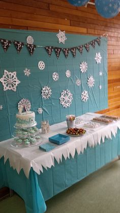 Frozen dessert table and display. I spent a few evenings making 6-point snowflakes which I spray painted in silver and while they were drying, threw a load of glitter on them. I'd have used a glitter spray but it's the wrong season. Easy and cheap decoration idea. White tablecloth from the 99p shop, snipped to look like icicles