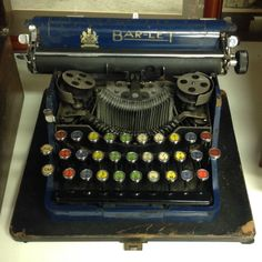 ANTIQUE BAR-LET NO2  RARE WORKING PORTABLE TYPE WRITER WITH MULTI COLOURED KEYS