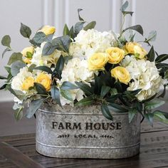 White-yellow Hudrangea centerpiece floral arrangement in galvanized farmhouse . White and yellow Hudrangea centerpiece floral arrangement in galvanized farmhouse . floral arrangements Always wanted . Succulent Centerpieces, Table Centerpieces, Table Decorations, Rustic Flower Arrangements, Hydrangea Centerpieces, Tropical Floral Arrangements, Wedding Decorations, Silk Arrangements, Easter Centerpiece