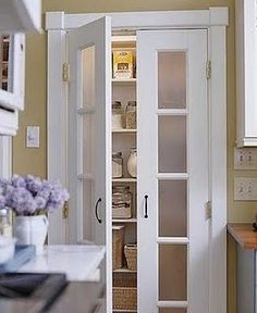 Replace ugly bi-fold doors with painted pantry doors or french doors - frost the glass