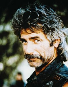 Sam Elliott. His voice is so sexy. I know it's him when I hear his voice on tv.  I dated a bullrider that looked like him. Mmmmmm