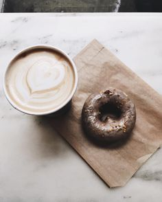 latte and doughnut from NYC coffee shop, Toby's Estate Cappuccino Machine, Cappuccino Coffee, Coffee Cozy, Coffee Break, Coffee Mugs, Coffee Art, Coffee Time, Nyc Coffee Shop, Almond Milk Latte