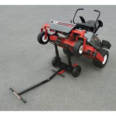 Use this heavy-duty lift to make servicing and cleaning your zero-turn mower easier than ever. A heavy-duty steel brace enables mower to stay upright while you change and service belts and blades, and telescoping lift bars provide extra height when needed. Black powder-coat finish resists rust and scratches