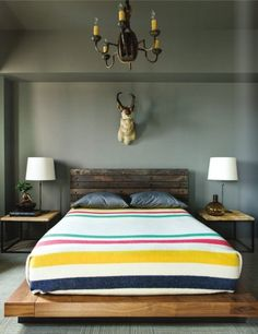The brightly striped bed cover offsets the grey walls and rugged rusticity of the headboard. Description from firstsense.wordpress.com. I searched for this on bing.com/images