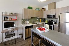 Contemporary Kitchen with Breakfast bar, Undermount sink, L-shaped, Subway Tile, Kitchen island, Complex granite counters