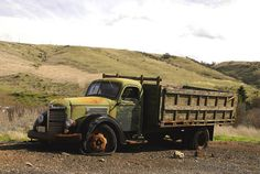 This old International truck hasn't run for years. It was once parked in a farmers field and was towed out of the way twice. Now its abandoned alongside this road.