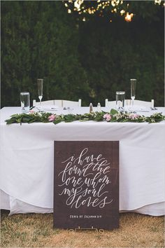 Simple and sweet sweetheart table. Love this wooden calligraphy sign that they placed in front of it! @weddingchicks
