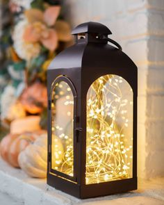 Create a soft magical glow for any fairytale wonderland. Lanterns Decor, Candle Lanterns, Candle Sconces, Slim Tree, Balsam Hill, Christmas Candle, Christmas Decorations, Led Fairy Lights, Magnolia Leaves