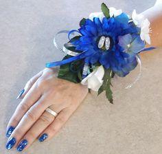 Delft blue miniature wooden shoes adorn this unique prom corsage.