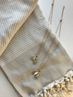Miz Casa & Co Cowrie Kiss Necklace Gold Arrow Necklace, Gold Necklace, Metal Casting, Gold Chains, 18k Gold, Shells, Kiss, Take That, Jewellery